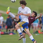 Justin Sheely | The Sheridan Press Sheridan's Noah Iberlin reacts as Plainsman Sergio Gardea kicks the ball away during the semifinal round of the boys 4A state tournament Friday at the Bi ...