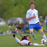 Justin Sheely | The Sheridan Press Sheridan's Wyat Dobbs drives the ball as Laramie's Ryan Petersmann slide-kicks during the semifinal round of the boys 4A state tournament Friday at the ...