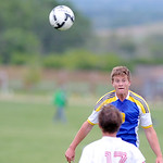 Sheridan's Gregg Sampson heads the ball away from the midfield during the third-place game at the boys 4A state tournament on Saturday, May 28 at the Big Horn Equestrian Center. Sheridan d ...