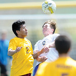 Mike Dunn | The Sheridan PressGregg Sampson, right, heads a ball Saturday at Big Horn High School. Sheridan beat Laramie 2-0.