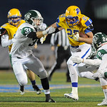 Sheridan's Parker Christensen (25) breaks through two Kelly Walsh tacklers on Friday, Sept. 22 at Homer Scott Field. Christensen finished with 154 rushing yards in Sheridan's 30-7 win. M ...