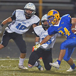 Kyle Custis (24) escapes two Cheyenne East defensive backs on his way to a 62-yard touchdown reception on Friday, Oct. 20 at Homer Scott Field. Custis finished the game with a rushing, recei ...