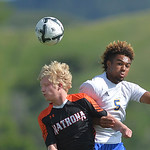 Justin Sheely | The Sheridan Press Sheridan's Dontae Crow, right, and Natrona's Casey Racki go for a header during the first round of the 4A state tournament Thursday at the Big Horn Equ ...