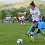 Justin Sheely | The Sheridan Press Sheridan's Brice Beisher looses the ball to Mustang goalkeeper during the first round of the 4A state tournament Thursday at the Big Horn Equestrian Cent ...