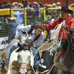 Bud Denega | The Sheridan Press Sheridan College's Chance Ames tries to get off Bunny Girl after the short round of bareback riding during the College National Finals Rodeo at the Casper E ...