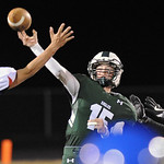 Quarterback Luke Stutzman launches a pass under pressure on Friday, Oct. 13 at Tongue River High School. Stutzman connected with J.T. Hammond for a 60-yard score. Mike Pruden | The Sheridan  ...