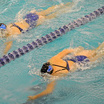 Jadyn Mullikin, left, and Piper Carroll swim neck and neck in the 100-meter backstroke during the Sheridan Invite on Saturday, Sept. 23 at Sheridan Junior High School. Mike Pruden | The Sher ...