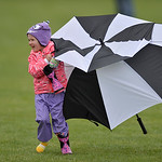 Justin Sheely | The Sheridan Press Two-year-old McKenna Matson retrieves her umbrella as her father coaches the Campbell County Lady Camels team during the girls class 4a State Championship  ...