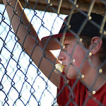 Justin Sheely | The Sheridan Press Reds player Mason Sisko watches his teammate go up to bat for a 5th and 6th grade matchup against the Dodgers during the Sheridan Recreation District's L ...