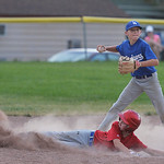 Justin Sheely | The Sheridan Press Dodgers' shortstop Brock Steel tags Reds player Mason Sisko for a 5th and 6th grade game during the Sheridan Recreation District's Little League Baseba ...