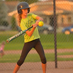 Justin Sheely | The Sheridan Press Peyton McLaughlin hits the ball during the Sheridan Recreation District's 6 – 8th grade Pony League girls softball championship game Wednesday at Oatts ...