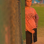 Justin Sheely | The Sheridan Press Annamay Hoops watches from the dugout during the Sheridan Recreation District's 6 – 8th grade Pony League girls softball championship game Wednesday at ...