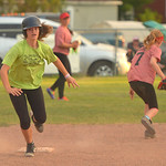 Justin Sheely | The Sheridan Press Ashley Billings runs to third as Braylin Keller retrieves the ball during the Sheridan Recreation District's 6 – 8th grade Pony League girls softball c ...