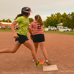 Justin Sheely | The Sheridan Press Avery Rader runs to first as Hanah Sullivan looks for the ball during the Sheridan Recreation District's 6 – 8th grade Pony League girls softball champ ...