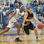 Gillette College's Abdul Mohamed, left, tries to poke the ball away from Sheridan College point guard Celio Araujo on Wednesday, Jan. 11 at the Pronghorn Center in Gillette. Mike Pruden |  ...