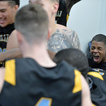 Xavier Jackson lets out a yell as he celebrates in the locker room with his teammates after Sheridan College's 83-77 victory over Gillette College on Wednesday, Jan. 11 at the Pronghorn Ce ...
