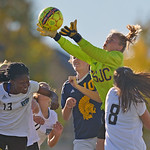 Trinidad State goalkeeper Maizy Burbank leaps to save the ball as Sheridan College's Fortune Kede (13) attempts to score on a corner kick on Friday, Oct. 20 at Maier Field. Mike Pruden | T ...