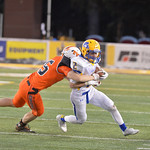 Ryan Patterson | The Sheridan Press  Sheridan's Toby Jacobs is tackled by a Natrona County defender during the 4A state championshp game at War Memorial Stadium in Laramie Saturday, Nov. 10, ...