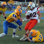 Joel Moline | The Sheridan Press Sheridan's Jacob Boint (12) and Garrett Coon (5) tackle Natrona's Braxton Bundy (22) Friday, Sept. 13, 2019.