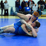 Joel Moline | The Sheridan Press Sheridan's Justin Vela has teammate Deeds Kirchner in a cradle, leading to a pin during the Blue/Gold Dual Tuesday, Dec. 10, 2019.