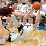 Joel Moline | The Sheridan Press Sheridan's Kevin Woodrow (41) dives on the floor to scoop up a loose ball and searches for a open teammate against Laramie High School Saturday, Feb. 15, 202 ...