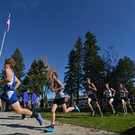 Justin Sheely | The Sheridan Press Runners go past the flagpole during the Class 4A boys State Cross-Country Championship Saturday at the Veterans Affairs Medical Campus in Sheridan.
