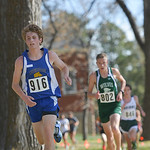 Justin Sheely | The Sheridan Press Sheridan's Brian Gonda runs under the trees during the Class 4A boys State Cross-Country Championship Saturday at the Veterans Affairs Medical Campus in  ...