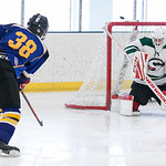 Tibby McDowell | The Sheridan Press Gunnar Swanson (38) narrowly misses a shot on goal against Pinedale in the semi-finals of the state tournament at Whitney Rink at the M&M's Center Saturda ...