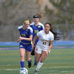 Matthew Gaston | The Sheridan PressSheridan's Courtney Wallach (13) brings the ball down the pitch under pressure during play against Larimie Saturday, March 23, 2019.