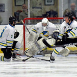 Joel Moline | The Sheridan Press Sheridan NA3HL Hawks players Sandis Cook (3) and Jonathan Bruno (5) try to block the puck before it reaches goalie James Downie (31) against the Missoula Jun ...