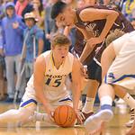 Justin Sheely   The Sheridan PressSheridan's Tristan Bower, left, strips the ball from Laramie High School's Hudda Herrera at Sheridan High School Friday, Jan. 19, 2018. The Broncs cru ...