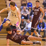 Justin Sheely   The Sheridan PressSheridan's Noah Erickson leaps over Laramie High School's Nathan Burma at Sheridan High School Friday, Jan. 19, 2018. The Broncs cruised past the Plai ...