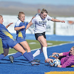 Bud Denega | The Sheridan Press Sheridan's Aria Heyneman, left, and Aubrey Cooper look to score during a game against Natrona County at Homer Scott Field Thursday, April 18, 2019.