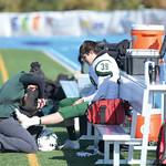 Matthew Gaston | The Sheridan PressTongue River's athletic trainer Jessica Garden works on full back Tony Perfetti's ankle at Homer Scott Field Saturday, Oct. 19, 2019.