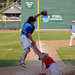 Sheridan catcher Noah Gustafson leaps to make a catch as a Laramie runner slides safely into home during the Troopers' 16-6 win over Laramie on Thursday, July 21 at Thorne-Rider Stadium. M ...