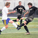 Dylan Ligocki, left, fights for the ball Monday at Homer Scott Field. The Broncs fell to Buffalo 1-0.