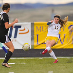 Katelynn Brooks, right, kicks the ball down field Monday at Homer Scott Field. The Lady Broncs beat Buffalo 3-0.
