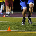A player sprints between cones during Big Horn High School's midnight football practice on Monday, August 15. Monday marked the first official practice day of the season for Big Horn and i ...