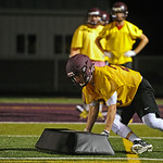 Colton Bates pushes a pad up the field during Big Horn High School's midnight football practice on Monday, August 15. Monday marked the first official practice day of the season for Big Ho ...
