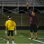 Assistant coach Colter Brantz, right, instructs defensive backs in a footwork drill during Big Horn High School's midnight football practice on Monday, August 15. Monday marked the first o ...