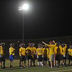 The Big Horn High School football team lines up before a drill under the lights during the Rams' annual midnight practice on Monday, August 15. Monday marked the first official practice da ...