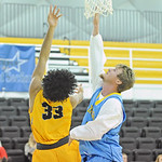 Sheridan College's Jeremiah Brown (33) shoots a reverse layup as Nick Sweeny attempts to block it on Monday, Dec. 5 at the Bruce Hoffman Golden Dome. Mike Pruden | The Sheridan Press