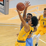 Sheridan College's Jeremiah Brown lays the ball up against Antoine Proctor on Monday, Dec. 5 at the Bruce Hoffman Golden Dome. Mike Pruden | The Sheridan Press