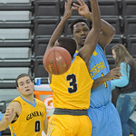 Former Sheridan College General Antoine Proctor, right, sneaks a pass between the arms of Sheridan College's Austin Sherrell during a game between SC and the Wyoming All-Stars on Monday, D ...
