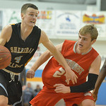 Justin Sheely | The Sheridan Press Sheridan General's Ladan Ricketts drives the ball past Blake Hinze during the game against Northwest College Saturday in the Bruce Hoffman Golden Dome at ...