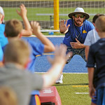 Sheridan High School assistant football coach Marshall McEwen demonstrates proper technique for a defensive lineman at the Sheridan High School football camp on Tuesday, July 19 at Homer Sco ...