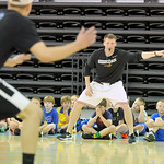 Campers look on as Sheridan College head men's basketball coach Matt Hammer takes some of his players through a defensive drill during the SC summer boys basketball camp on Tuesday, June 1 ...