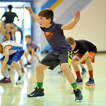 Brennan Bolton widens his defensive stance at the Sheridan College summer boys basketball camp on Tuesday, June 14 at the Bruce Hoffman Golden Dome. Mike Pruden | The Sheridan Press