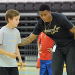 Sheridan College men's basketball player Montrail Johnson, right, instructs camper Mason Manning at the Sheridan College summer boys basketball camp on Tuesday, June 14 at the Bruce Hoffma ...