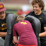 Big Horn football players Colton Williams, left, and Kade Eisele, right, sandwich a camper during a running back drill at Thursday's Justin O'Dell Memorial football camp at Big Horn High ...